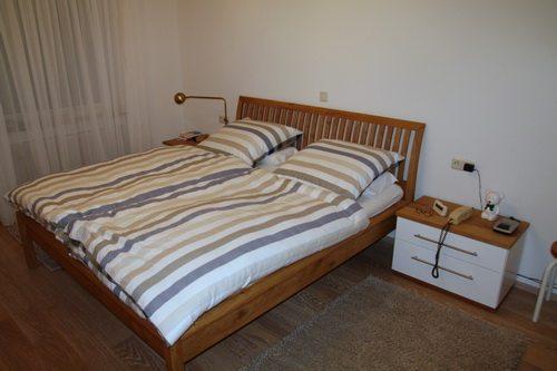 Bett in Wildeiche geölt mit Sprossen Kopfteil