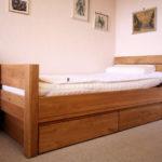 Jugendbett mit Bettschublade aus Vollholz